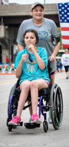 Mom Pushing Daughter In Wheelchair at Marathon