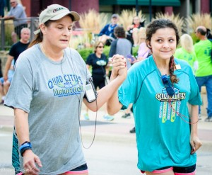 Mom and Daughter Crossing Finish Line at Marathon